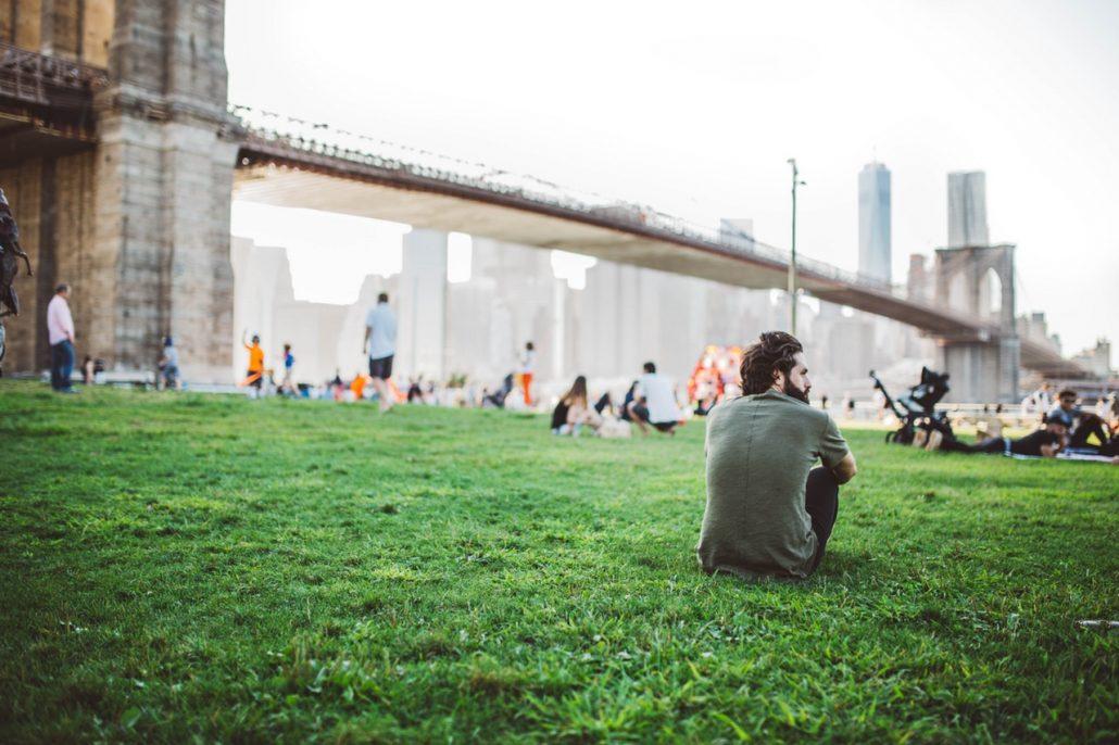 Man sitting on waterfront